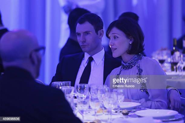 Richard Flood and Gabriella Pession pose during the Children for Peace Benifit Gala at Spazio Novecento on November 28 2014 in Rome Italy