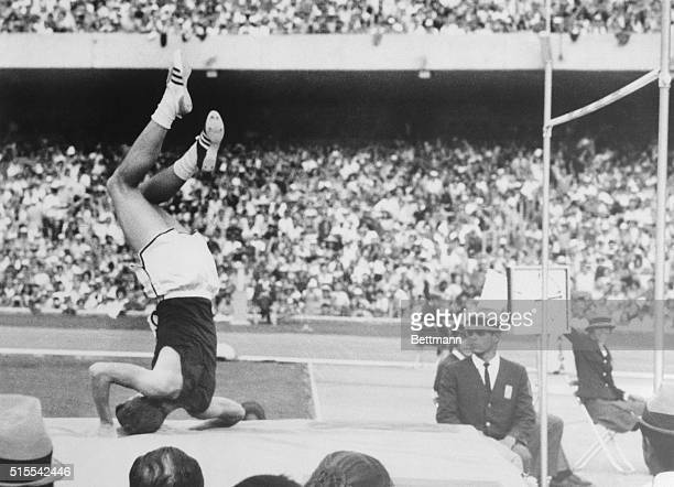 Richard Fosbury of Medford Oregon lands on his head here after clearing 7 feet 2 3/4 inches in the high jump Fosbury who slides over the crossbar...