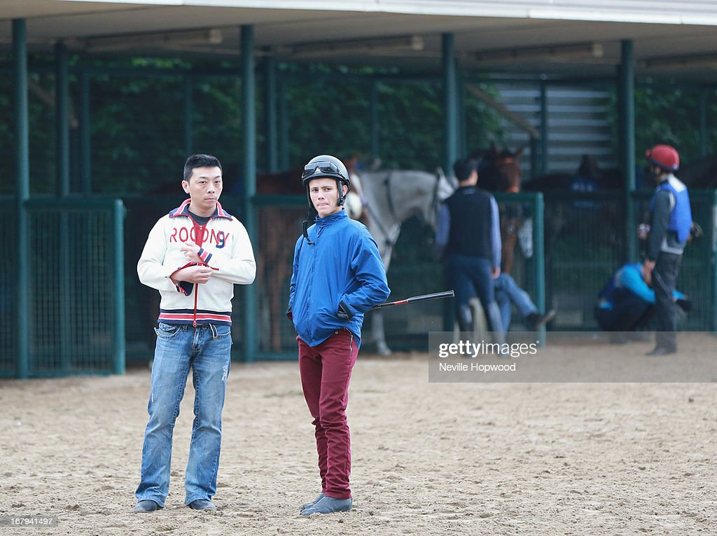 Richard Fourie (R) looks on during a trackwork session at Sha Tin racecourse on May 3, 2013, ahead of the Champions Mile this Sunday in Hong Kong, Hong Kong.