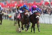 Richard Fourie riding Legislate wins on appeal from Wylie Hall ridden by MJByleveld the 2200m Grade 1 Vodacom Durban July during at the 2014 Vodacom...