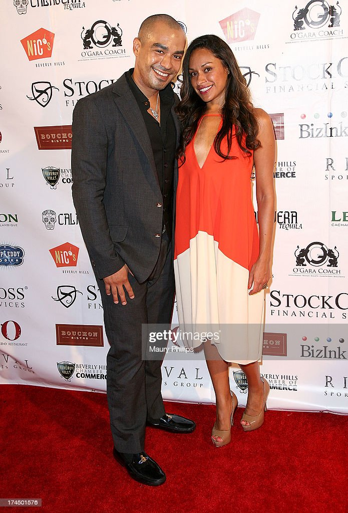 Richard Gallardo and guest arrive at the 40th Anniversary StockCross Party on July 25, 2013 in Beverly Hills, California.