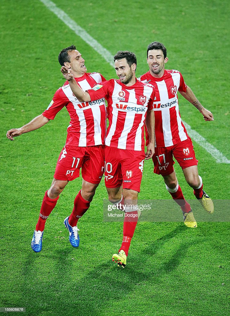 Richard Garcia, Josip Tadic and Jason Hoffman of the Heart celebrate a Tadic penalty goal during the round six A-League match between the Melbourne Heart and the Brisbane Roar at AAMI Park on November 9, 2012 in Melbourne, Australia.
