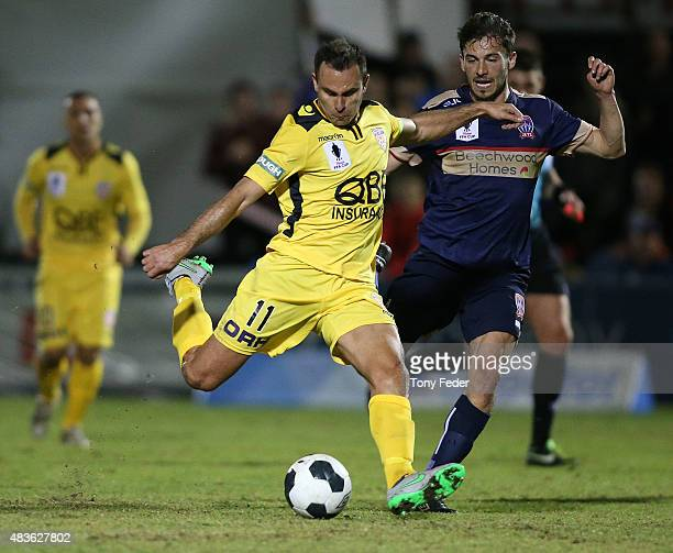 Richard Garcia of the Glory contests the ball with Mateo Poljak of the Jets during the FFA Cup match between Newcastle Jets and Perth Glory at Magic...