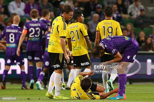 Richard Garcia of the Glory gestures to Vince Lia of the Phoenix as referee Lucien Laverdure issues a red card Ruben Zadkovich of the Glory during...