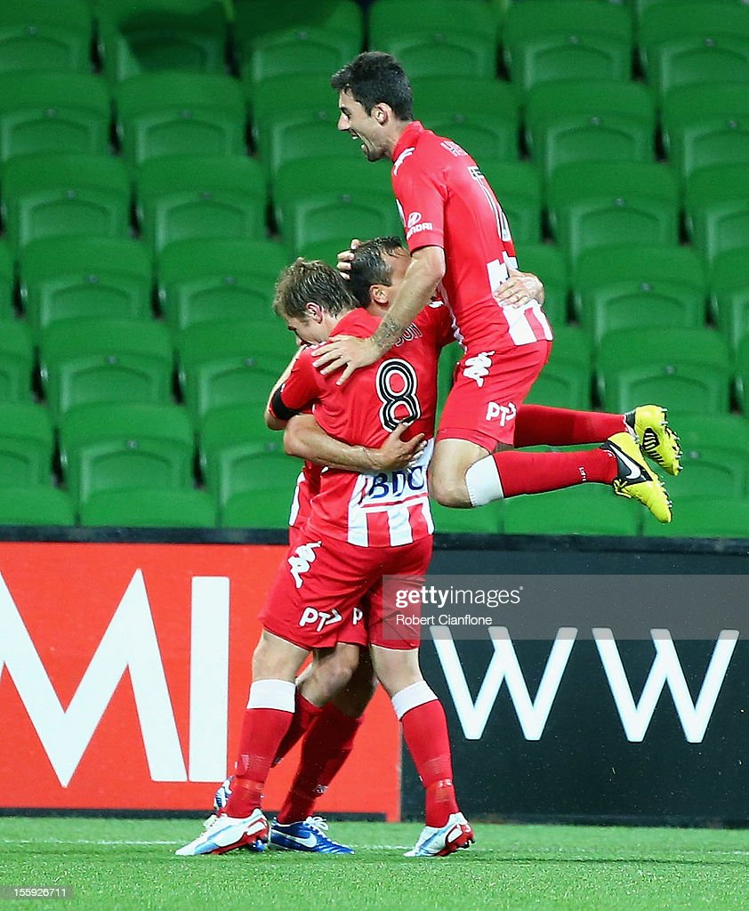 Richard Garcia of the Heart celebrates his goal with teammates during the round six A-League match between the Melbourne Heart and the Brisbane Roar at AAMI Park on November 9, 2012 in Melbourne, Australia.