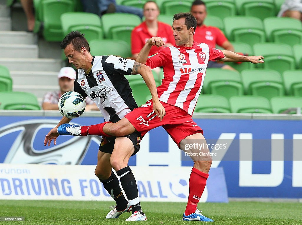 Richard Garcia of the Heart challenges Ryan Griffiths of the Jets during the round eight ALeague match between the Melbourne Heart and the Newcastle...