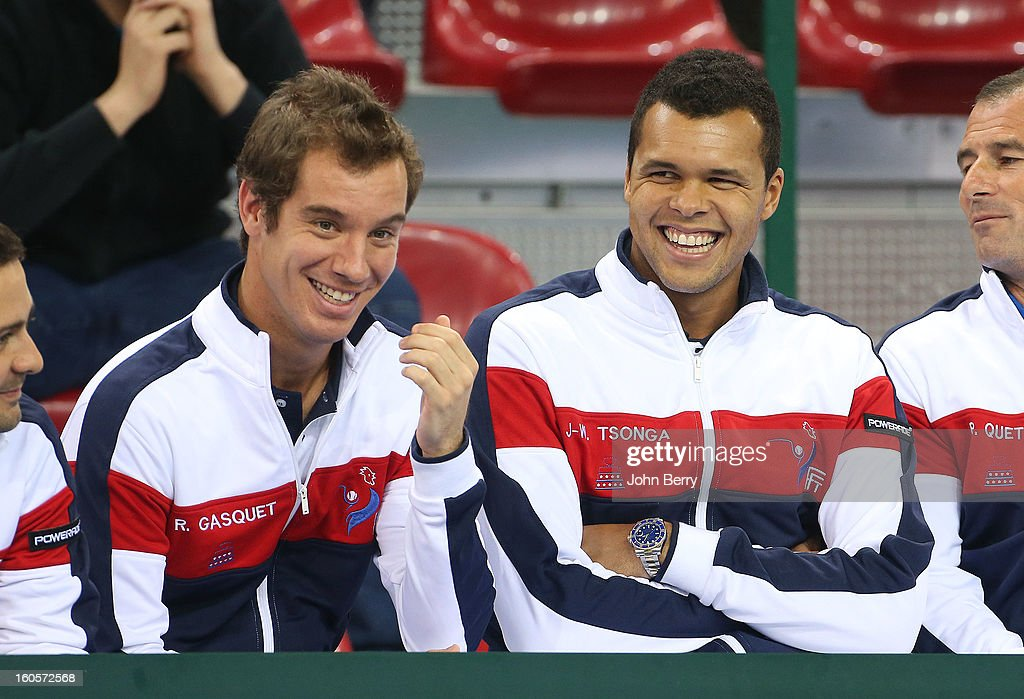 Richard Gasquet and Jo-Wilfried Tsonga of France share a laugh during the doubles match on day two of the Davis Cup first round match between France and Israel at the Kindarena stadium on February 2, 2013 in Rouen, France.