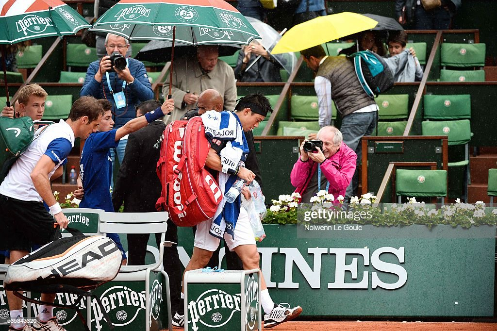 Richard Gasquet and Kei Nishikori, play is interrupted due to rain during the Men's Singles on day eight of the French Open 2016 on May 29, 2016 in Paris, France.