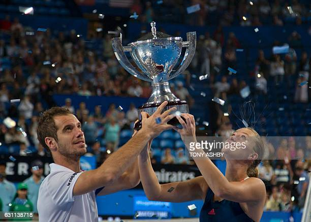 Richard Gasquet and Kristina Mladenovic of France celebrate with their trophy after defeating Coco Vandeweghe and Jack Sock of the US in the mixed...