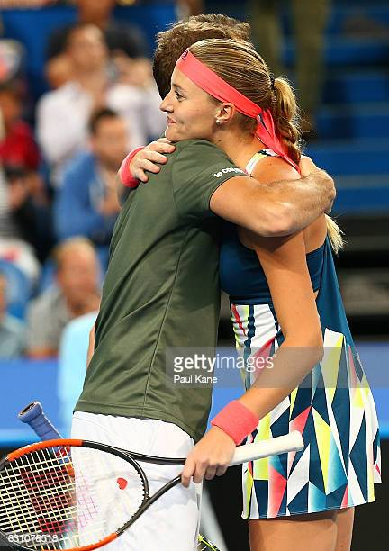 Richard Gasquet and Kristina Mladenovic of France embrace after defeating Roger Federer and Belinda Bencic of Switzerland in the mixed doubles match...