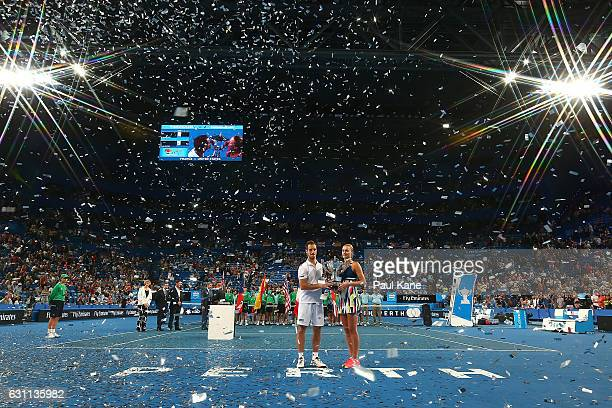 Richard Gasquet and Kristina Mladenovic of France hold the Hopman Cup trophy after winning the final against Coco Vandeweghe and Jack Sock of the...