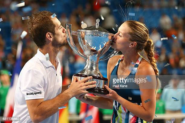 Richard Gasquet and Kristina Mladenovic of France kiss the Hopman Cup trophy after winning the final against Coco Vandeweghe and Jack Sock of the...