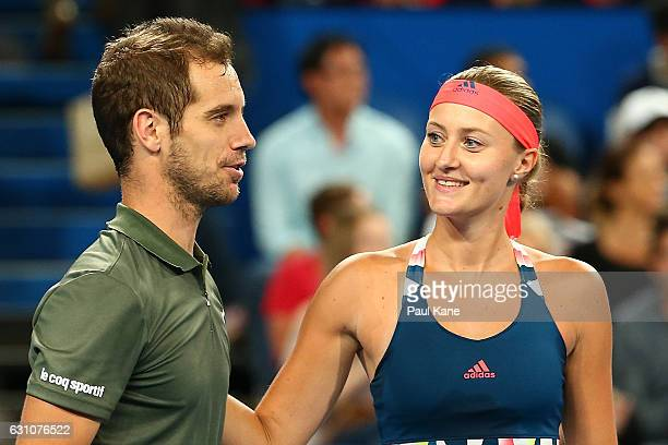 Richard Gasquet and Kristina Mladenovic of France look on after defeating Roger Federer and Belinda Bencic of Switzerland in the mixed doubles match...