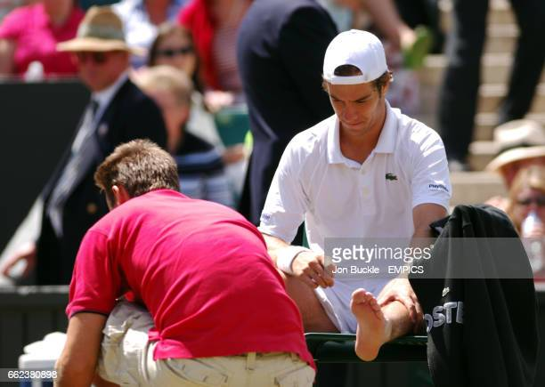 Richard Gasquet is treated for an foot/ankle injury