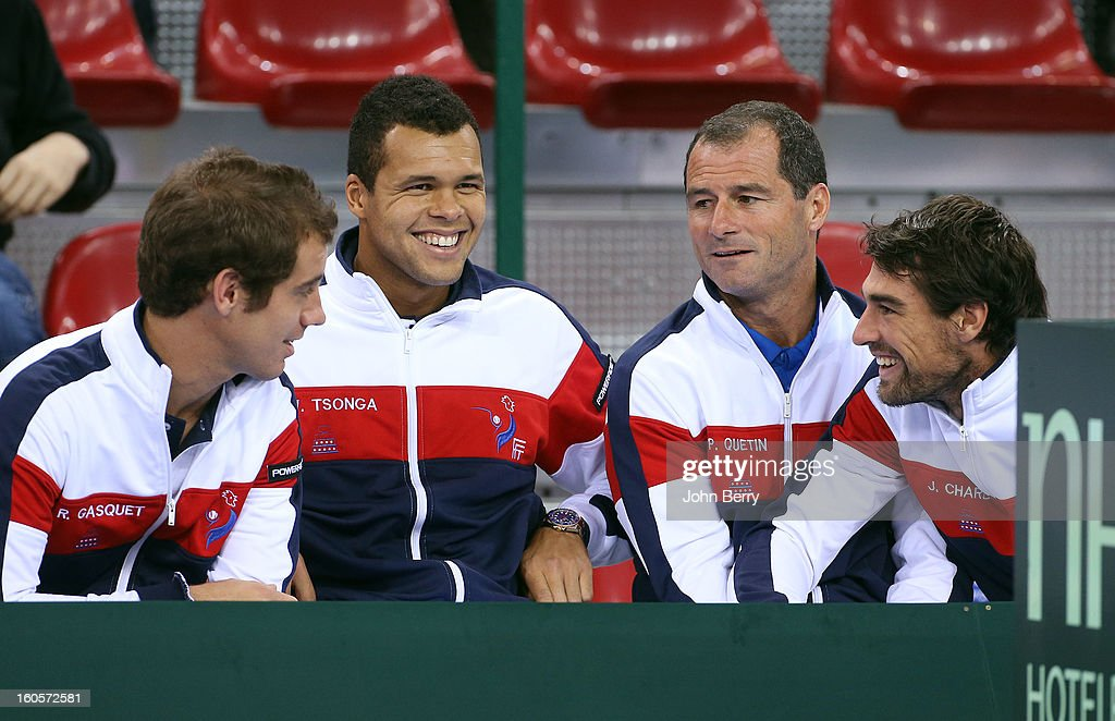 Richard Gasquet, Jo-Wilfried Tsonga, Paul Quetin, fitness coach and Jeremy Chardy of France share a laugh during the doubles match on day two of the Davis Cup first round match between France and Israel at the Kindarena stadium on February 2, 2013 in Rouen, France.