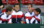 Richard Gasquet JoWilfried Tsonga Paul Quetin fitness coach and Jeremy Chardy of France share a laugh during the doubles match on day two of the...