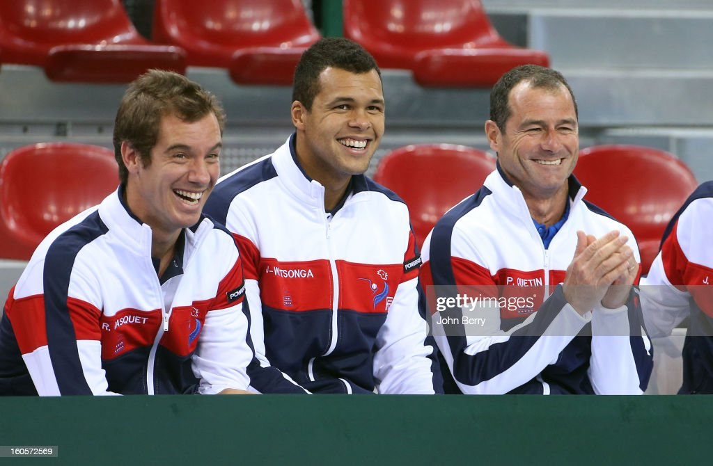Richard Gasquet, Jo-Wilfried Tsonga, Paul Quetin, fitness coach of France share a laugh during the doubles match on day two of the Davis Cup first round match between France and Israel at the Kindarena stadium on February 2, 2013 in Rouen, France.
