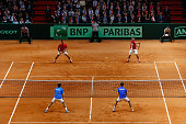 Richard Gasquet of France and Julien Benneteau of France in action against Roger Federer of Switzerland and Stanislas Wawrinka of Switzerland in the...