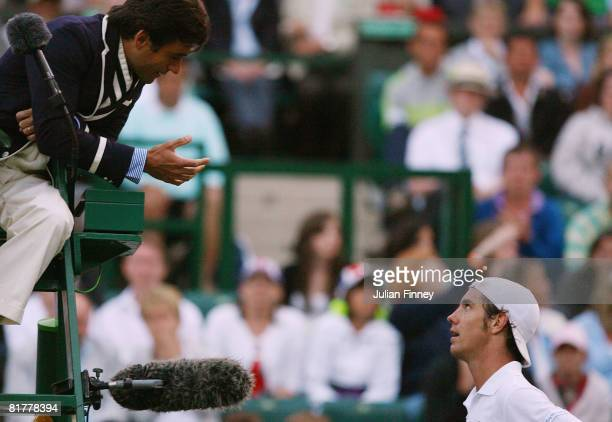 Richard Gasquet of France argues with the umpire during the men's singles round four match against Andy Murray of Great Britain on day seven of the...