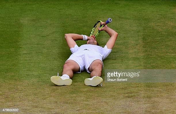 Richard Gasquet of France celebrates at match point winning his Gentlemens Singles Quarter Final match against Stanislas Wawrinka of Switzerland...