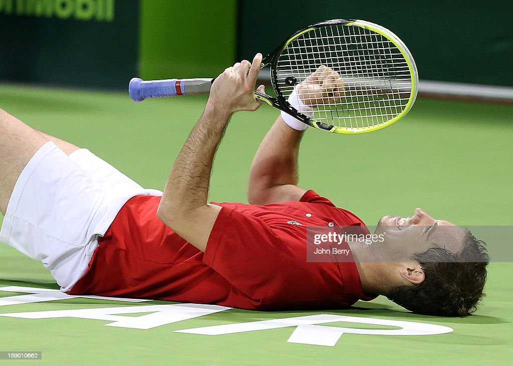 Richard Gasquet of France celebrates his victory after his final against Nikolay Davydenko of Russia on day six of the Qatar Open 2013 at the Khalifa International Tennis and Squash Complex on January 5, 2013 in Doha, Qatar.