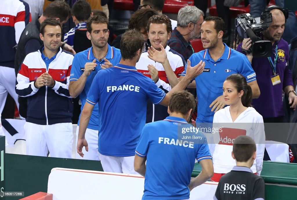 <a gi-track='captionPersonalityLinkClicked' href=/galleries/search?phrase=Richard+Gasquet&family=editorial&specificpeople=206501 ng-click='$event.stopPropagation()'>Richard Gasquet</a> of France (C) celebrates his victory with teammates after his match against Dudi Sela of Israel on day one of the Davis Cup first round match between France and Israel at the Kindarena stadium on February 1, 2013 in Rouen, France.