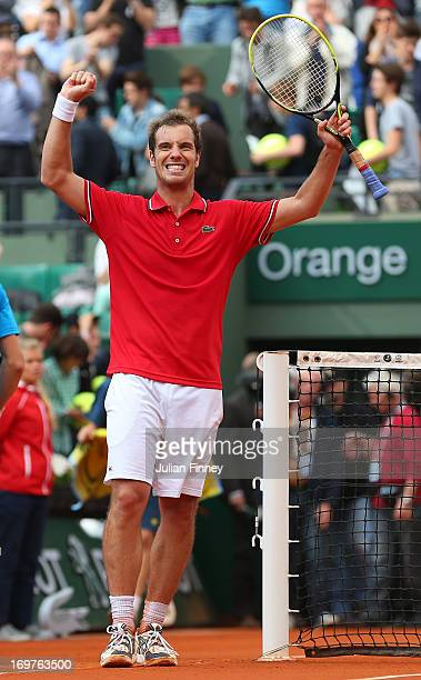 Richard Gasquet of France celebrates match point in his Men's Singles match against Nikolay Davydenko of Russia during day seven of the French Open...