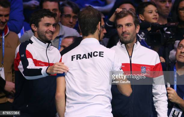 Richard Gasquet of France celebrates winning the doubles match with Gilles Simon and Julien Benneteau on day 2 of the Davis Cup World Group final...