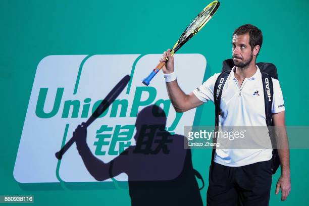 Richard Gasquet of France enters the tennis court during the Men's singles quarter final mach against Roger Federer of Switzerland on day six of 2017...