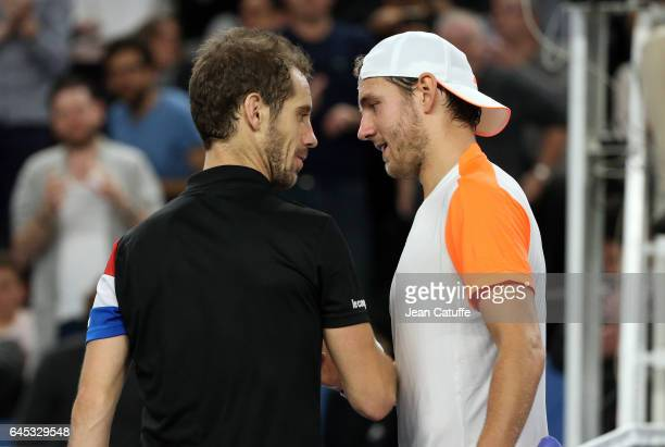 Richard Gasquet of France greets winner Lucas Pouille of France following their semifinal at the Open 13 an ATP 250 tennis tournament at Palais des...