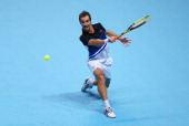 Richard Gasquet of France hits a backhand during his men's singles match against Roger Federer of Switzerland during day four of the Barclays ATP...