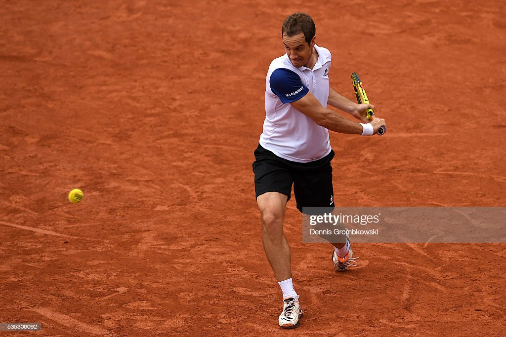 <a gi-track='captionPersonalityLinkClicked' href=/galleries/search?phrase=Richard+Gasquet&family=editorial&specificpeople=206501 ng-click='$event.stopPropagation()'>Richard Gasquet</a> of France hits a backhand during the Men's Singles fourth round match against Kei Nishikori of Japan on day eight of the 2016 French Open at Roland Garros on May 29, 2016 in Paris, France.