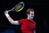 Richard Gasquet of France hits a backhand in his men's singles match against Juan Martin Del Potro of Argentina during day one of the Barclays ATP...