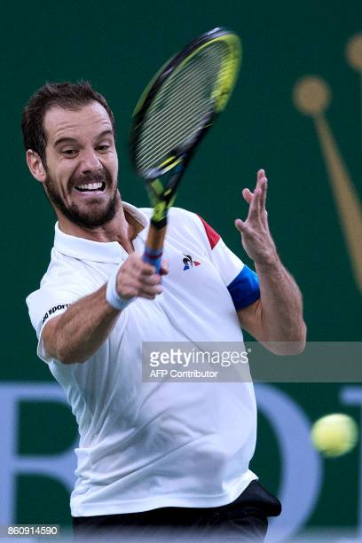 Richard Gasquet of France hits a return during his men's quarterfinals singles match against Roger Federer of Switzerland at the Shanghai Masters...