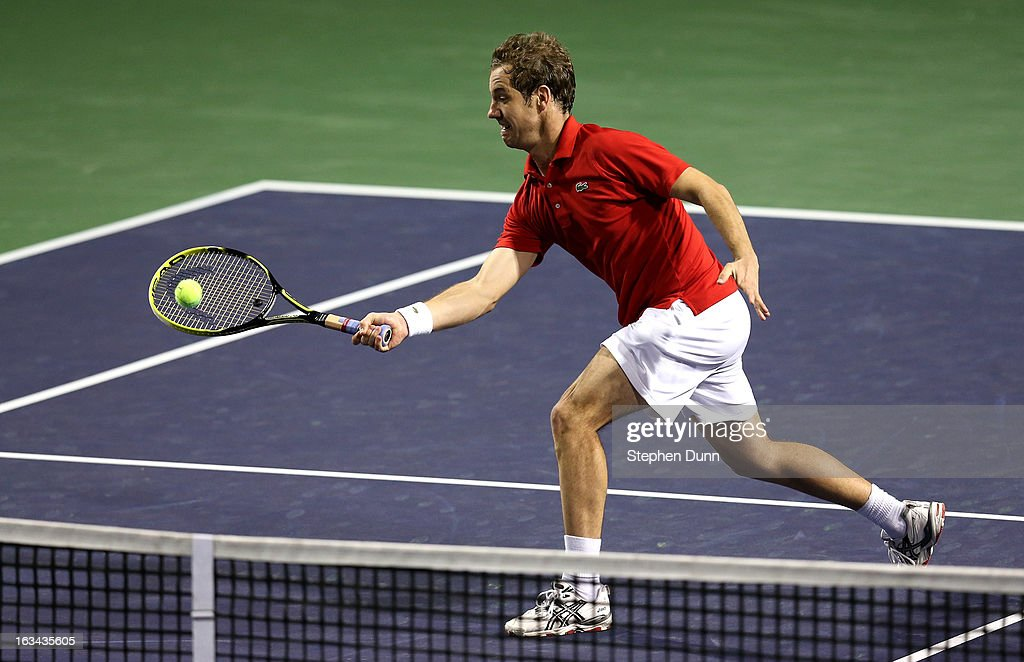 Richard Gasquet of France hits a return to Bernard Tomic of Australia during day 4 of the BNP Paribas Open at Indian Wells Tennis Garden on March 9, 2013 in Indian Wells, California.