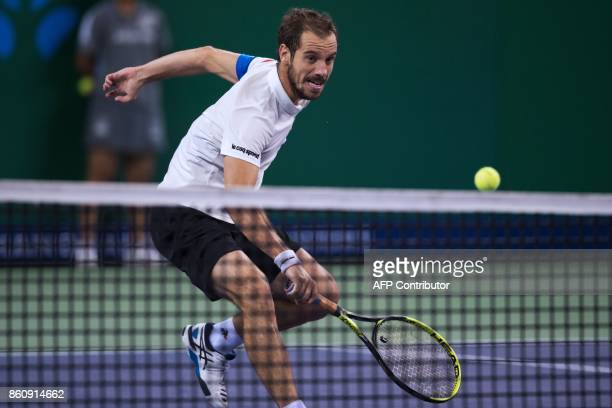 Richard Gasquet of France hits a volley during his men's quarterfinals singles match against Roger Federer of Switzerland at the Shanghai Masters...