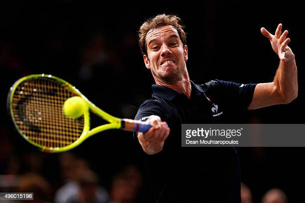 Richard Gasquet of France in action against Andy Murray of Great Britain during Day 5 of the BNP Paribas Masters held at AccorHotels Arena on...