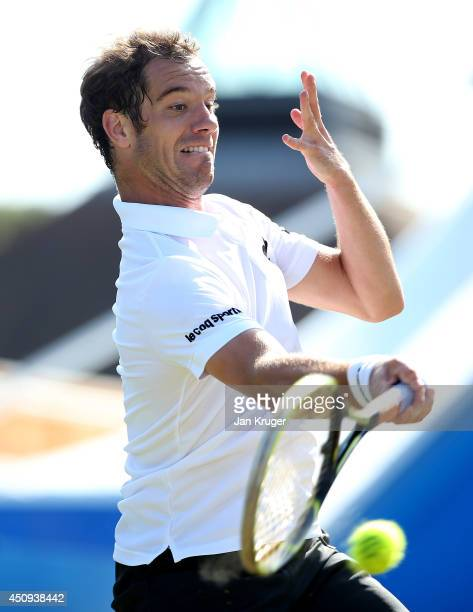 Richard Gasquet of France in action against Denis Istomin of Uzbekistan during their singles match on day seven of the Aegon International at...