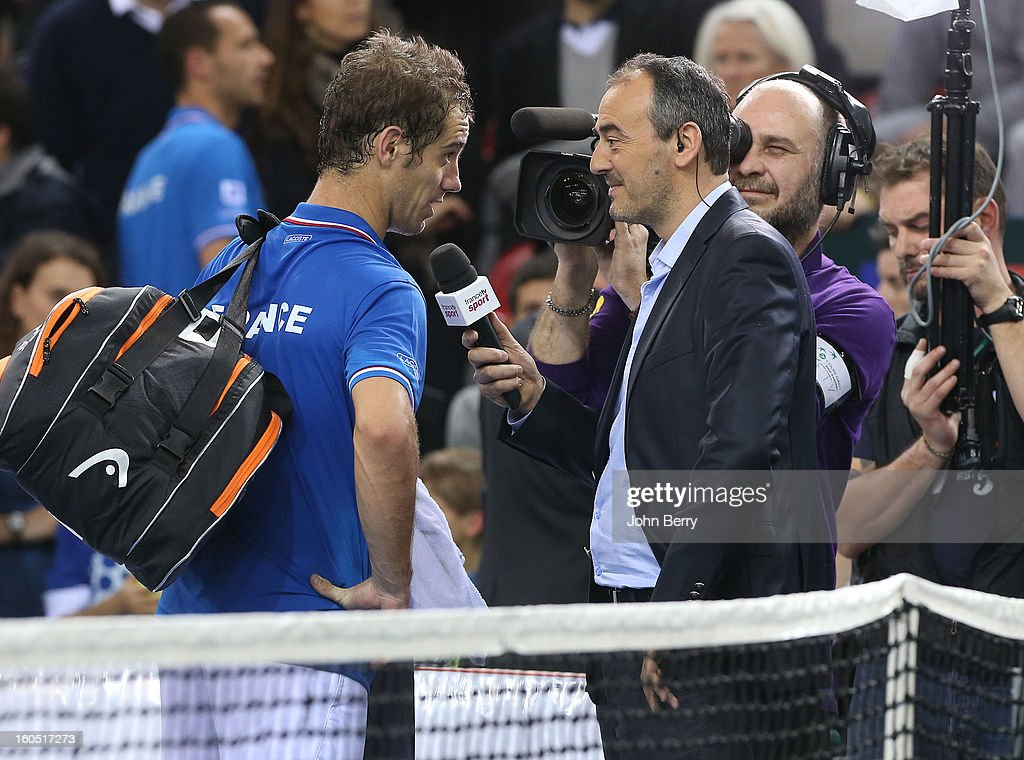 Richard Gasquet of France is interviewed by tv presenter Francois Brabant after his match against Dudi Sela of Israel on day one of the Davis Cup first round match between France and Israel at the Kindarena stadium on February 1, 2013 in Rouen, France.