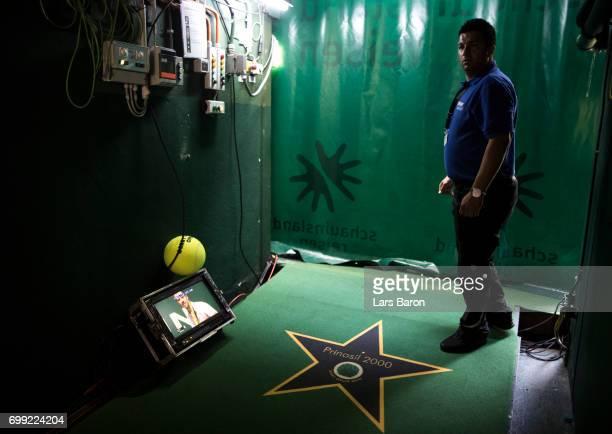 Richard Gasquet of France is seen on a screen in the players tunnel during his match against Bernard Tomic of Australia during Day 5 of the Gerry...