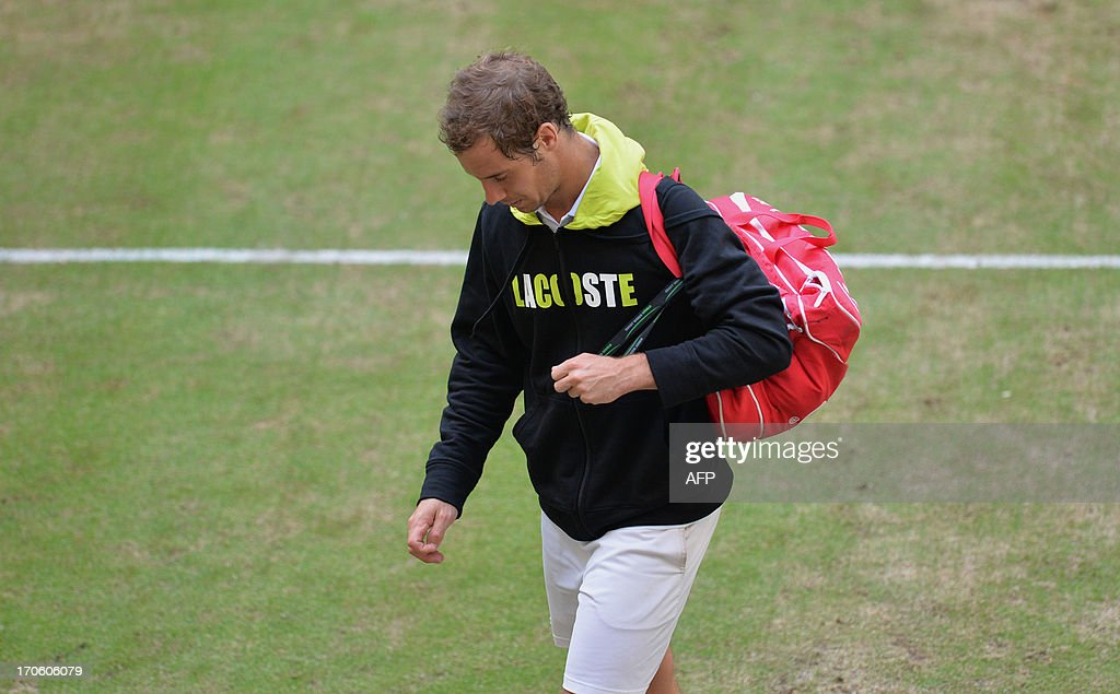 Richard Gasquet of France leaves the pitch after his semifinal match against Russia's Mikhail Youzhny at the ATP Gerry Weber Open tennis tournament in Halle, western Germany on June 15, 2013. Youzhny won the match 6-3, 6-2.