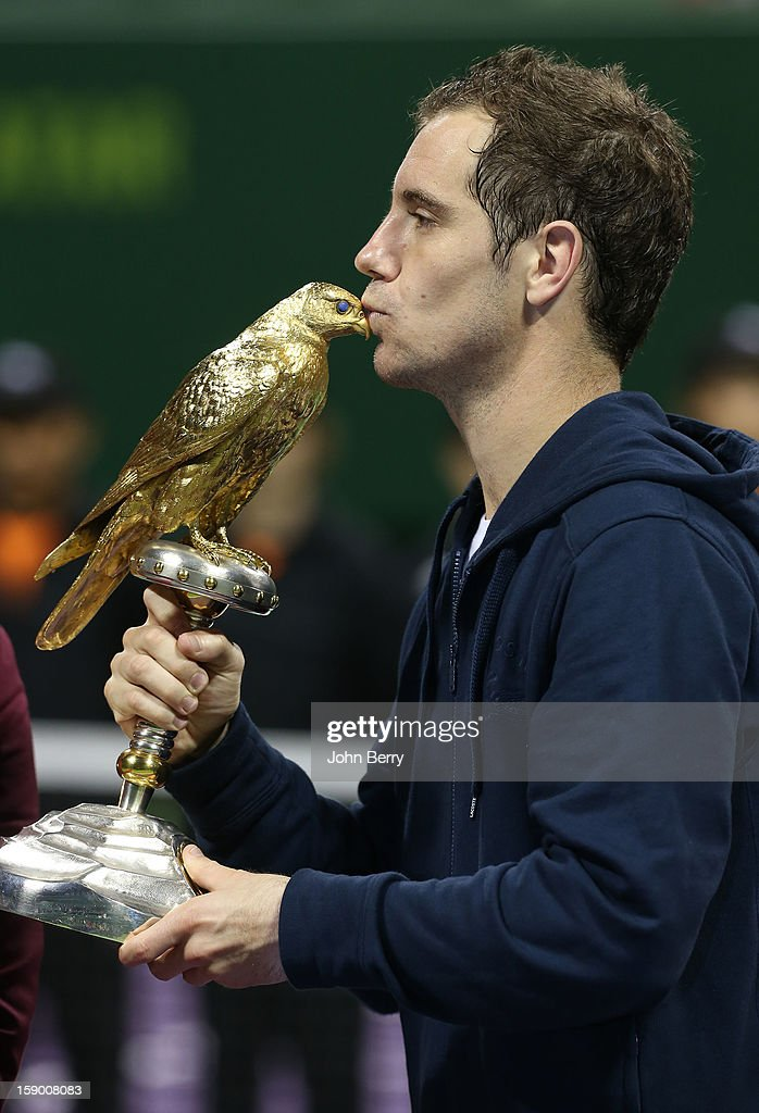 <a gi-track='captionPersonalityLinkClicked' href=/galleries/search?phrase=Richard+Gasquet&family=editorial&specificpeople=206501 ng-click='$event.stopPropagation()'>Richard Gasquet</a> of France lifts the trophy after defeating in final Nikolay Davydenko of Russia in day six of the Qatar Open 2013 at the Khalifa International Tennis and Squash Complex on January 5, 2012 in Doha, Qatar.