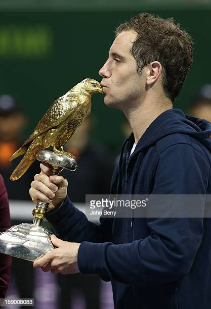 Richard Gasquet of France lifts the trophy after defeating in final Nikolay Davydenko of Russia in day six of the Qatar Open 2013 at the Khalifa...