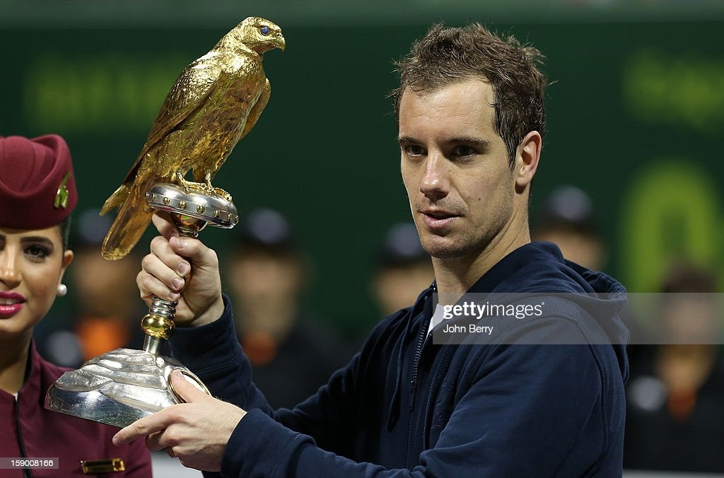 Richard Gasquet of France lifts the trophy after defeating in final Nikolay Davydenko of Russia in day six of the Qatar Open 2013 at the Khalifa International Tennis and Squash Complex on January 5, 2013 in Doha, Qatar.