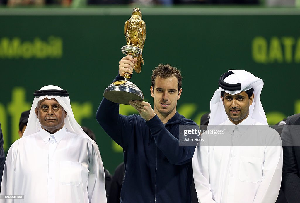 <a gi-track='captionPersonalityLinkClicked' href=/galleries/search?phrase=Richard+Gasquet&family=editorial&specificpeople=206501 ng-click='$event.stopPropagation()'>Richard Gasquet</a> of France lifts the trophy and poses with <a gi-track='captionPersonalityLinkClicked' href=/galleries/search?phrase=Nasser+Al-Khelaifi&family=editorial&specificpeople=7941556 ng-click='$event.stopPropagation()'>Nasser Al-Khelaifi</a>, President of the Qatar Tennis Federation and President of Paris Saint-Germain, after defeating in the final Nikolay Davydenko of Russia in day six of the Qatar Open 2013 at the Khalifa International Tennis and Squash Complex on January 5, 2013 in Doha, Qatar.