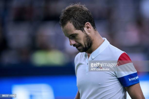Richard Gasquet of France looks down before a match point during his men's quarterfinals singles match against Roger Federer of Switzerland at the...