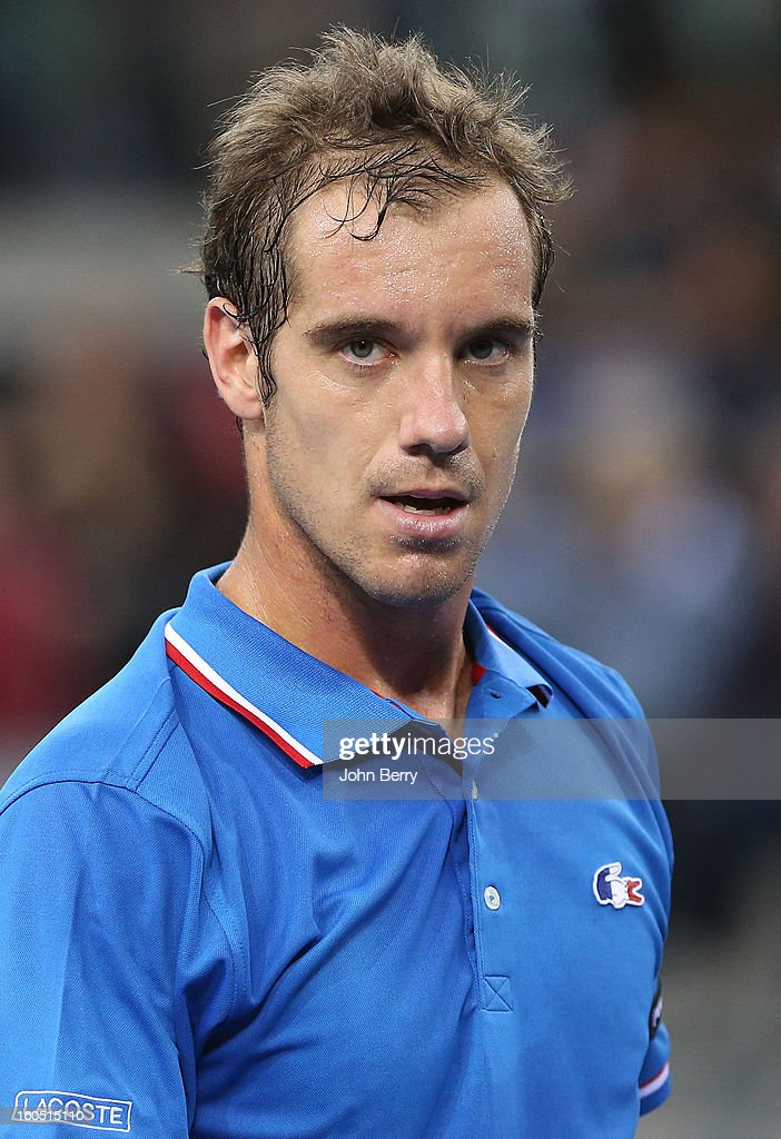 <a gi-track='captionPersonalityLinkClicked' href=/galleries/search?phrase=Richard+Gasquet&family=editorial&specificpeople=206501 ng-click='$event.stopPropagation()'>Richard Gasquet</a> of France looks on during his match against Dudi Sela of Israel on day one of the Davis Cup first round match between France and Israel at the Kindarena stadium on February 1, 2013 in Rouen, France.