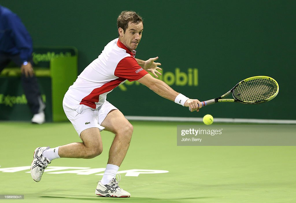 <a gi-track='captionPersonalityLinkClicked' href=/galleries/search?phrase=Richard+Gasquet&family=editorial&specificpeople=206501 ng-click='$event.stopPropagation()'>Richard Gasquet</a> of France plays a backhand during his semi-final against Daniel Brands of Germany in day five of the Qatar Open 2013 at the Khalifa International Tennis and Squash Complex on January 4, 2013 in Doha, Qatar.