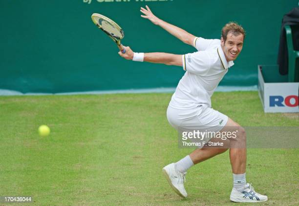 Richard Gasquet of France plays a backhand in his match against Jurgen Melzer of Austria during day four of the Gerry Weber Open at Gerry Weber...