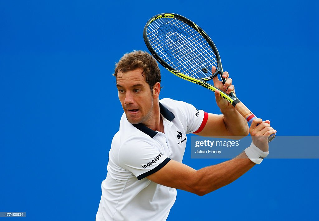 Richard Gasquet of France plays a backhand in his men's singles second round match against Milos Raonic of Canada during day three of the Aegon...